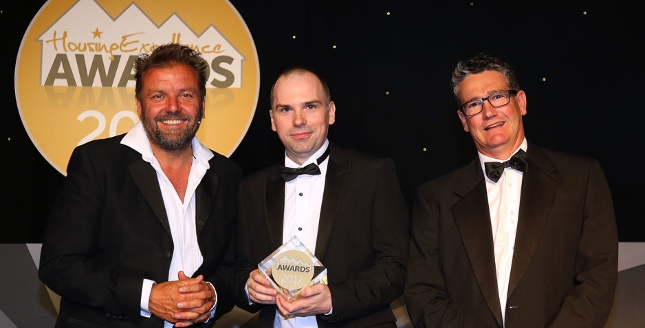 Stephen accepting the award from host Martin Roberts